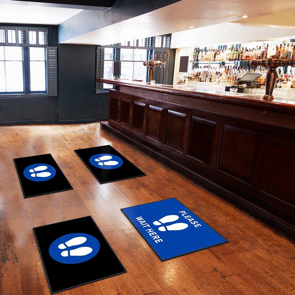 social distancing mats at pub bar