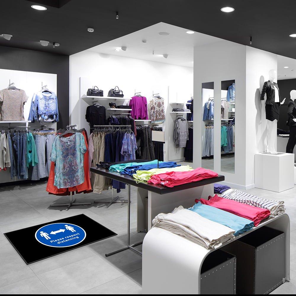 social distancing floor mat in retail store