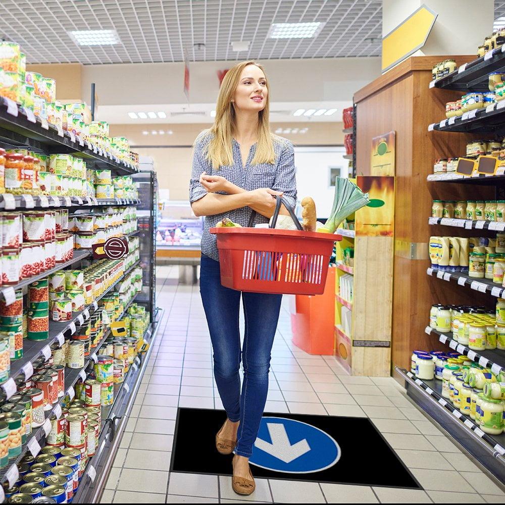 directional floor sign mat in supermarket