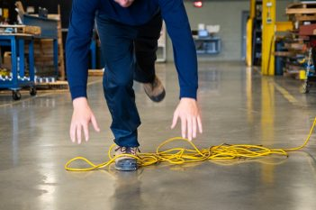 person tripping over cable-750x500